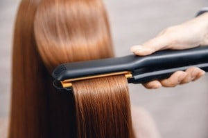 Keratin recovery hair and protein treatment pile with professional ultrasonic iron tool. Concept straighten