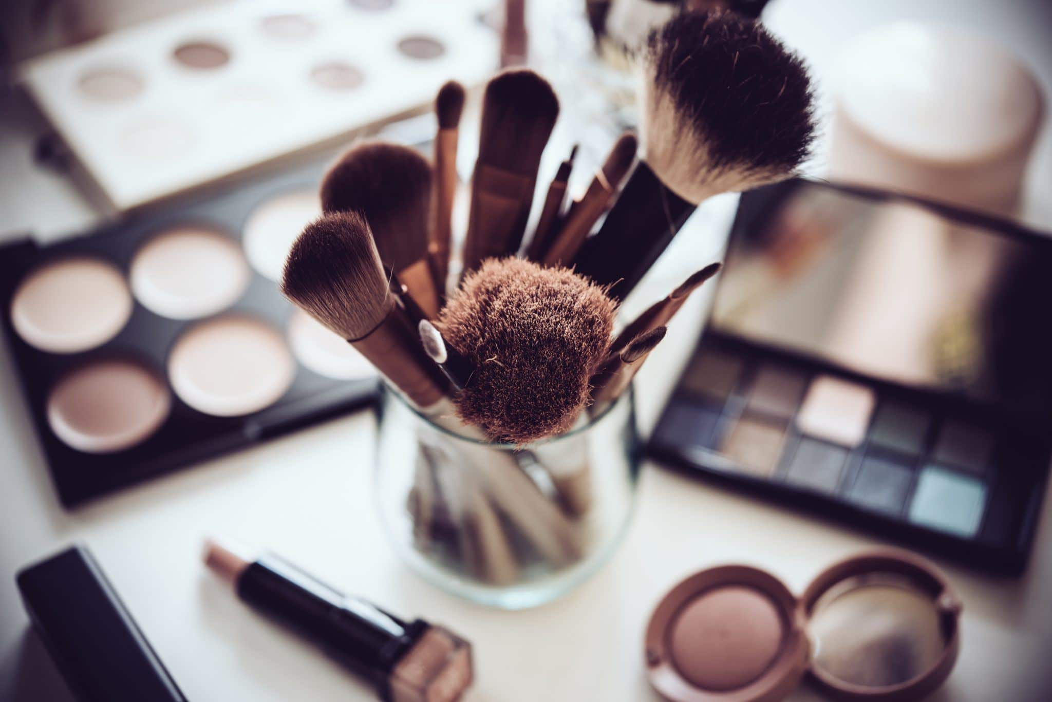 makeup and brushes on a vanity