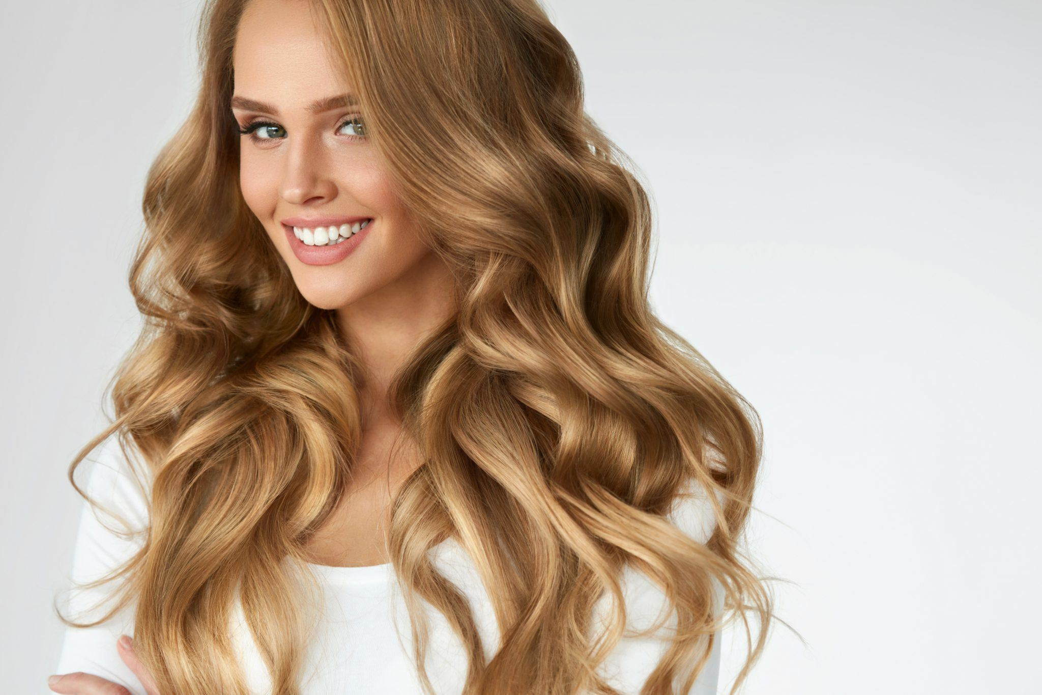 smiling woman with beautiful and healthy hair