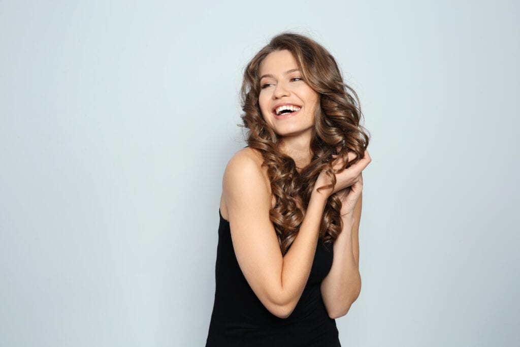 Woman smiling with beautiful hair