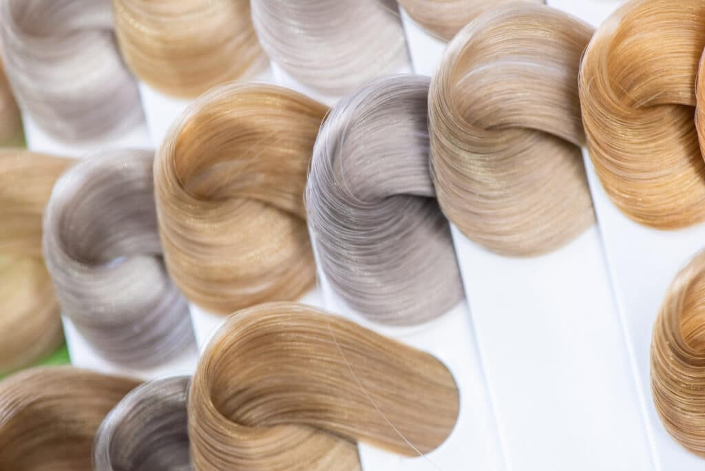 different shades of blonde hair on swatches