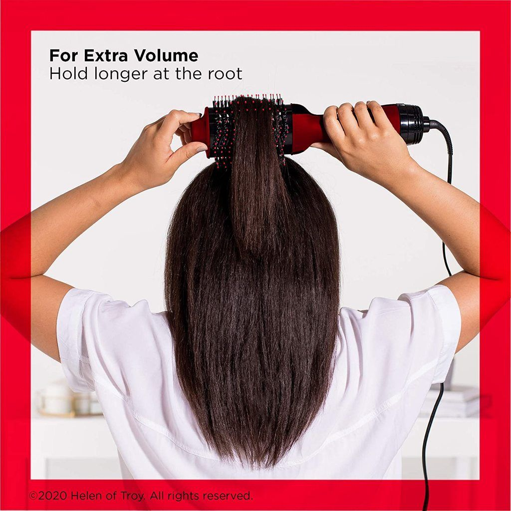 A woman using the Revlon OneStep Hair Dryer and Volumizer Hot Air Brush