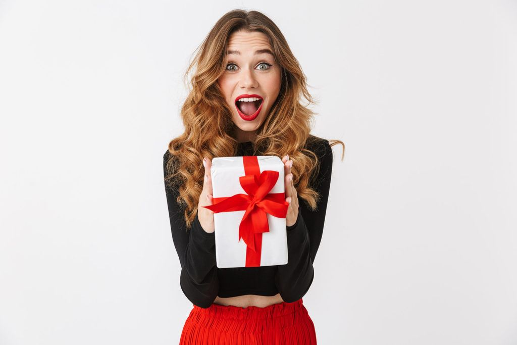 A woman holding a beautifully wrapped gift