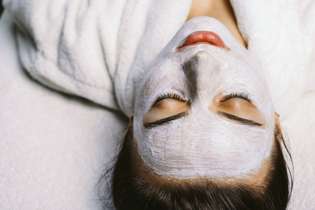 A woman relaxing with a face mask on